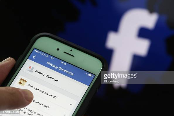 Privacy setting shortcuts are displayed on Apple Inc iPhone 6 smartphone screen as a FaceBook Inc logo is seen in this arranged photograph taken in...