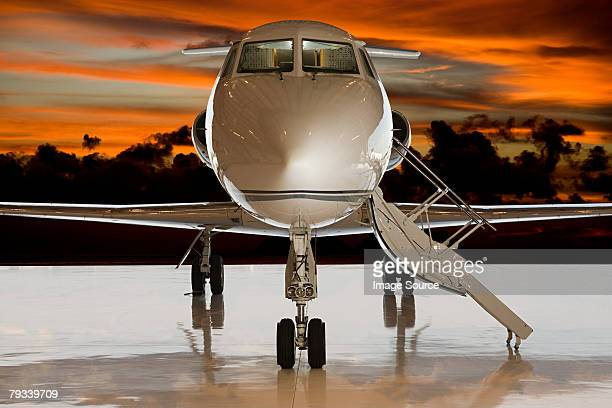 Private airplane at sunset