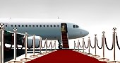 Private airplane boarding on red carpet