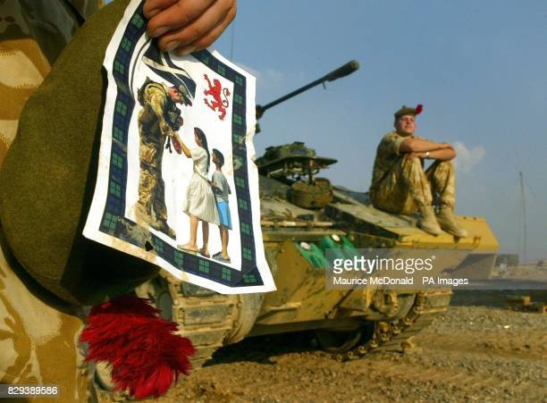 Private Alan McGillvray from Glasgow of the Black Watch holds a flyer that has been printed by the army It carries a message in Arabic alongside a...