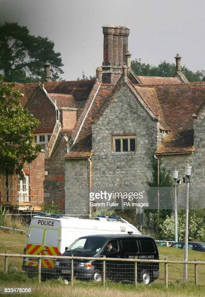 A private ambulance drives away the body of a female teacher who was murdered in the grounds of East Sutton Park Prison near Maidstone in Kent