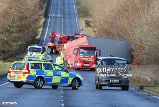 A private ambulance leaves the scene after an accident where a lorry driver died as his HGV toppled on to a number of cars on the A801 in West...