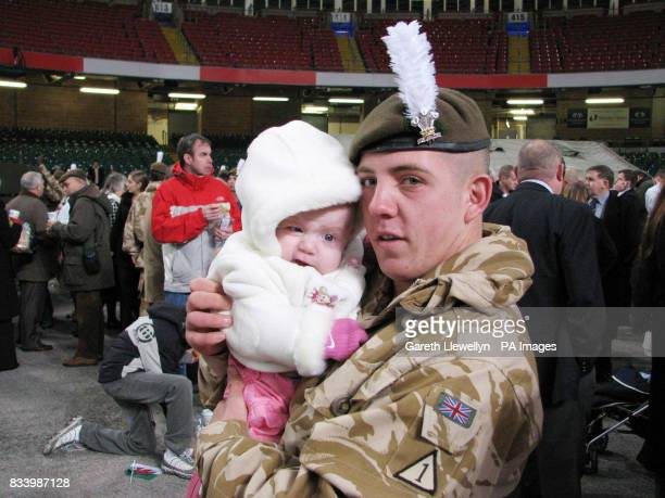 Private Anthony Berry with his twomonthold daughter AlishaMarie in the Millennium Stadium part of the 450 soldiers serving with the 2nd Battalion The...