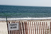 Private Beach sign on fence at the ocean