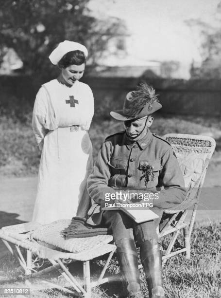 Private Burke signs his autograph for a Voluntary Aid nurse at Rose Hall a convalescent home in Darlinghurst Sydney circa 1917 Private Burke is one...