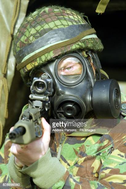 Private Charlie Curnow of the Paratroopers 3rd Battalion practice wearing gas masks at a press day at Friday Woods near their barracks in Colchester...