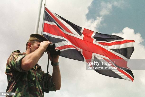 Private Chris Richmond of the Black Watch keeps a look out over the river border crossing between the new territories of Hong Kong and China at the...