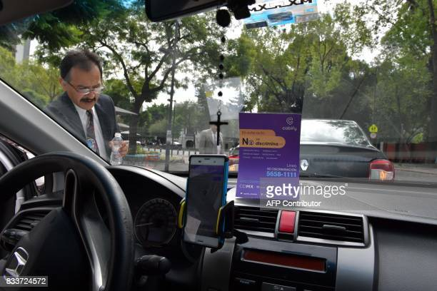 A private company taxi driver prepares to provide his service during the launch of a campaign against discrimination promoted by the Council to...