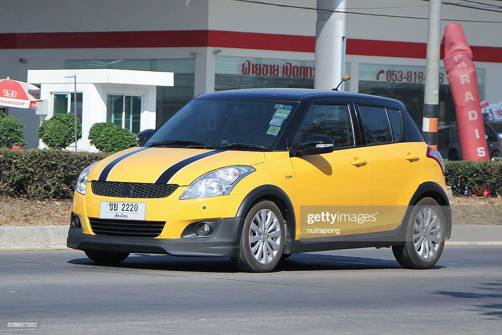 Private Eco car, Suzuki Swift : Stock Photo
