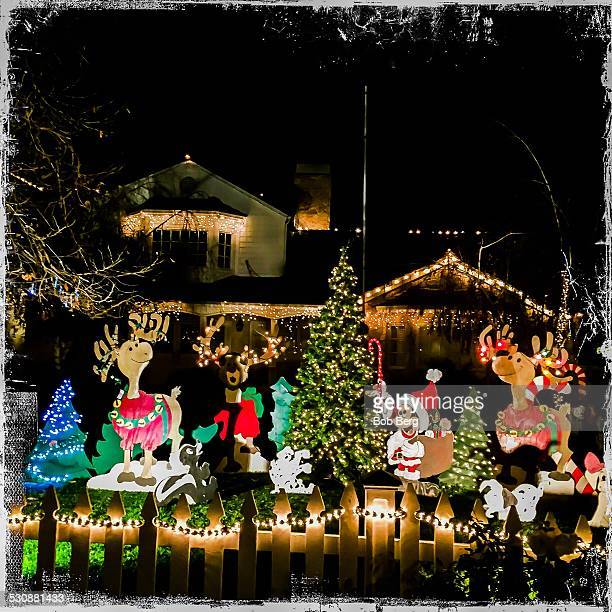 Woodland Hills Ca December 17 2014 A private home is transformed into a Christmas lights display featuring christmas Mickey Mouse along 'Candy Cane...