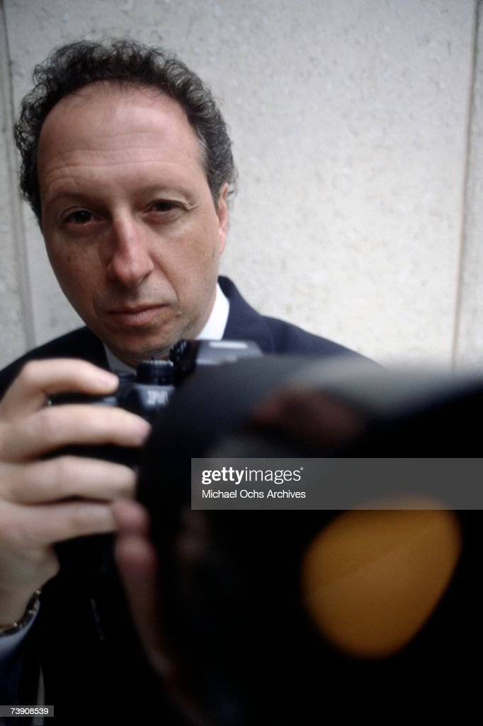Private investigator to the stars Anthony Pellicano poses with his camera in February 1992 in Los Angeles, California.