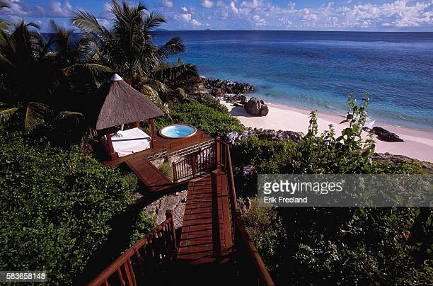 A private Jacuzzi overlooks a beach and the Indian Ocean at Fregate Island Private resort The exclusive resort is located on the privately run...