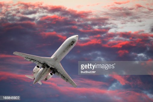 Private Jet Airplane Flying in a Colorful Sky : Stock Photo
