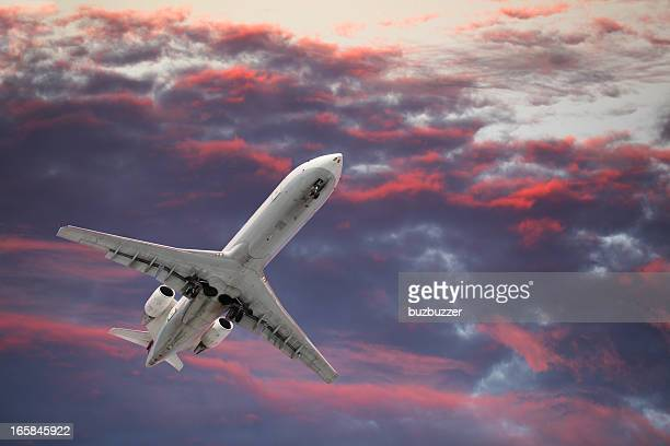 Private Jet Airplane Flying in a Colorful Sky