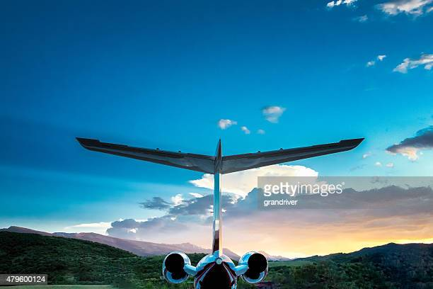 Private Jet in the Mountains at Dusk
