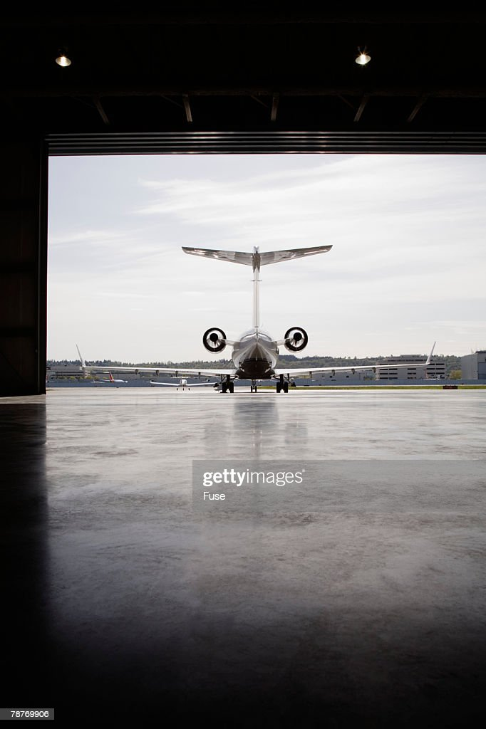 Private Jet Parked Outside Hangar