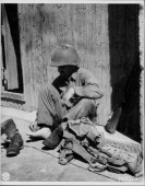 Private Joe D Brusco of New Jersey 3rd Division resting after the capture of Brignoles during World War Two France 1944