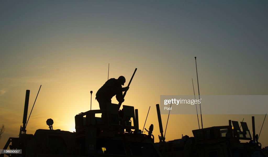 Private Martin Borglit of the 3rd Brigade Combat Team, 1st Cavalry Division installs the mounted gun on his unit's Mine Resistant Ambush Protected (MRAP) vehicle to be part of the last U.S. military convoy to leave Camp Adder on December 17, 2011 near Nasiriyah, Iraq. All U.S. troops were scheduled to have departed Iraq by December 31st, 2011. At least 4,485 U.S. military personnel died in service in Iraq. According to the Iraq Body Count, more than 100,000 Iraqi civilians have died from war-related violence.