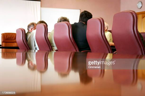 Private meeting with business people sitting in red chairs