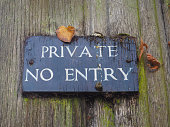 private no entry warning sign on a wooden door
