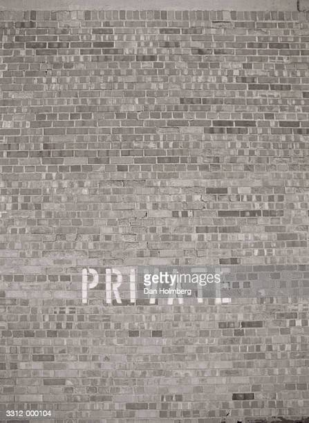 Private on Brick Wall