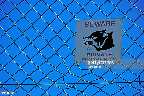 Private property warning sign on fence