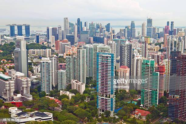 Private residential buildings in the Orchard Road area foreground and commercial buildings in the central business district background stand in...