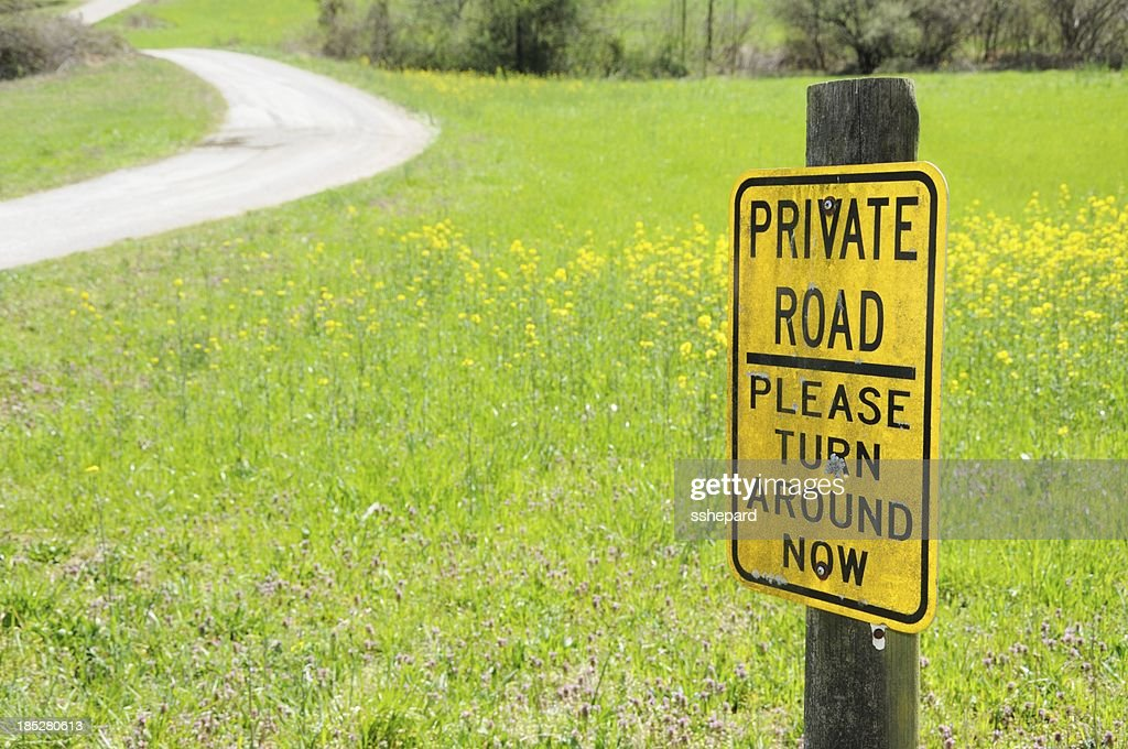 Private road please turn around now sign