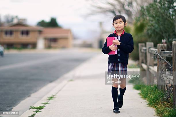 Private school girl walking home from school