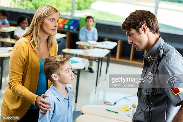 Private school student listens to security officer