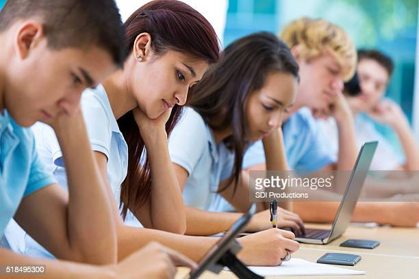 Private school students work in class