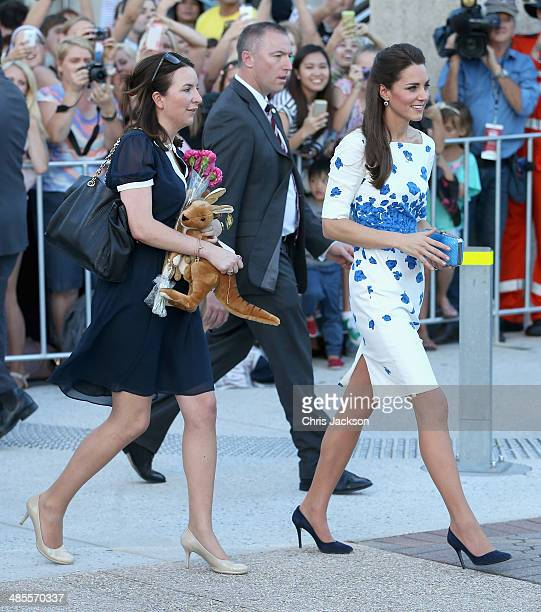 Private Secretary Rebecca Deacon carries a stuffed Kangaroo as Catherine Duchess of Cambridgas she does a walkabout on the South Bank on April 19...