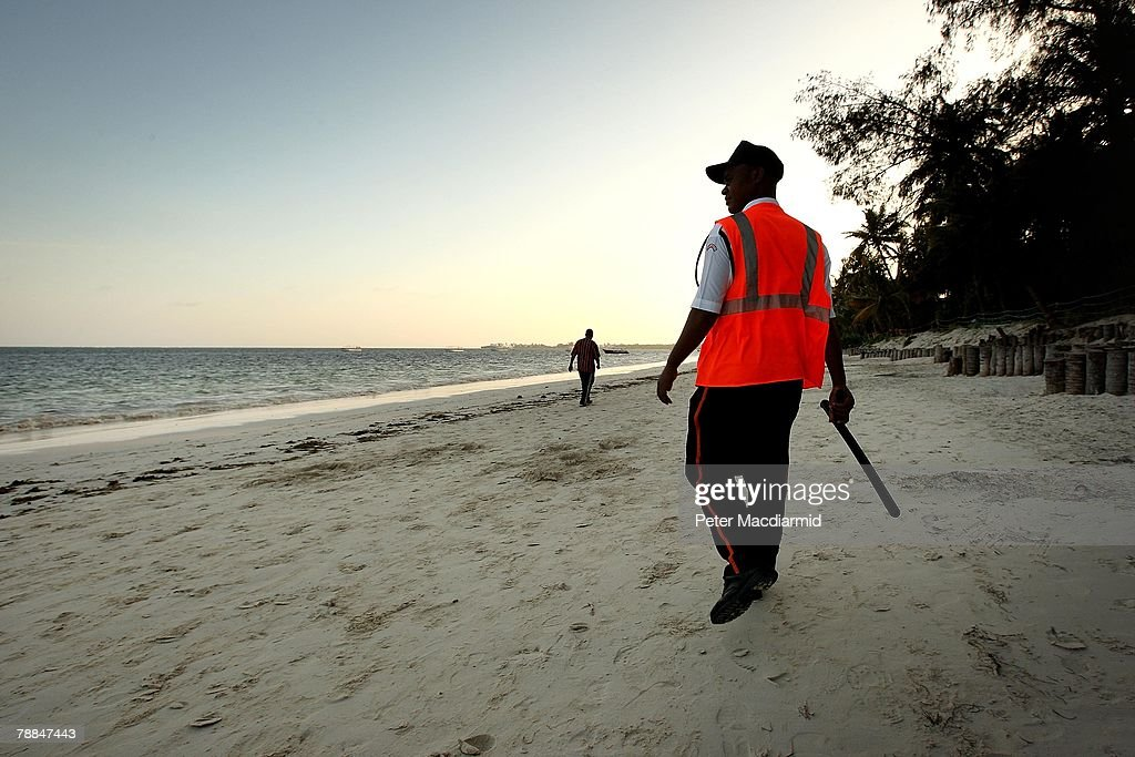 A private security guard from a hotel keeps watch on the beach on January 9, 2008 in Mombasa, Kenya. Tourism is a $1 billion industry in Kenya. Some tour operators have temporarily banned package holidays over fear of post election violence.