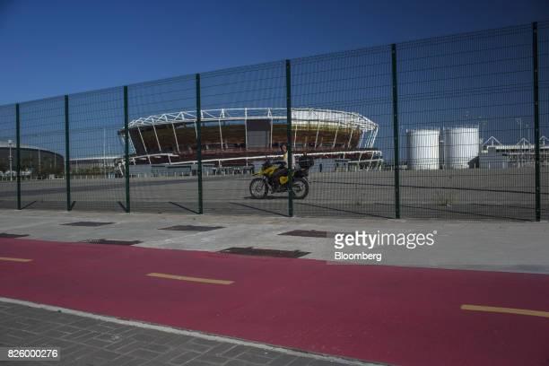 A private security guard patrols inside a closed Olympic Park in the Barra da Tijuca neighborhood of Rio de Janeiro Brazil on Wednesday Aug 2 2017...