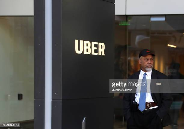 A private security guard stands in front of Uber headquarters on June 13 2017 in San Francisco California Uber CEO Travis Kalanick announced plans to...