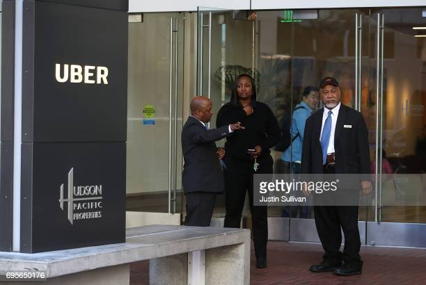 Private security guards stand in front of Uber headquarters on June 13 2017 in San Francisco California Uber CEO Travis Kalanick announced plans to...