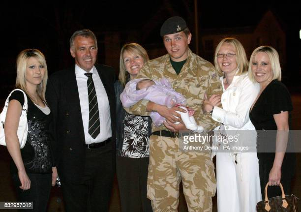 Private Stephen Huyton from the 1st Battalion The Staffordshire Regiment is greeted by Natasha Huyton parents Major Stephen Huyton and Julie Huyton...