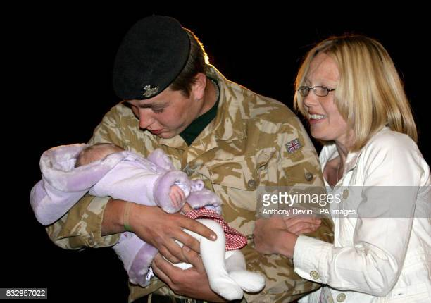 Private Stephen Huyton from the 1st Battalion The Staffordshire Regiment kisses daughter Alexa Huyton and fiance Cheryl Jones on his return to camp...