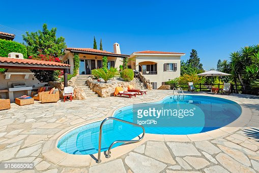 Private swimming pool and patio area : Stock Photo