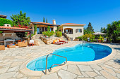 Private swimming pool and patio area outside Cyprus villa