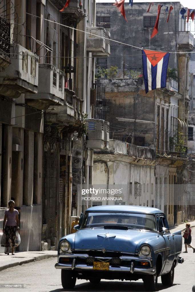 A private taxi runs by old Havana 03 May 2007. The VI Hemispheric Summit Against Free Trade Agreement and for People Integration, starts on Thursday in the Cuban capital. AFP PHOTO Rodrigo ARANGUA / AFP PHOTO / Rodrigo ARANGUA