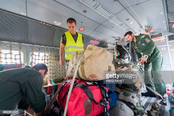 Privates load relief into a French Army logistical transport plane bound for Vanuatu transporting food water and relief at the Aerial Military Base...