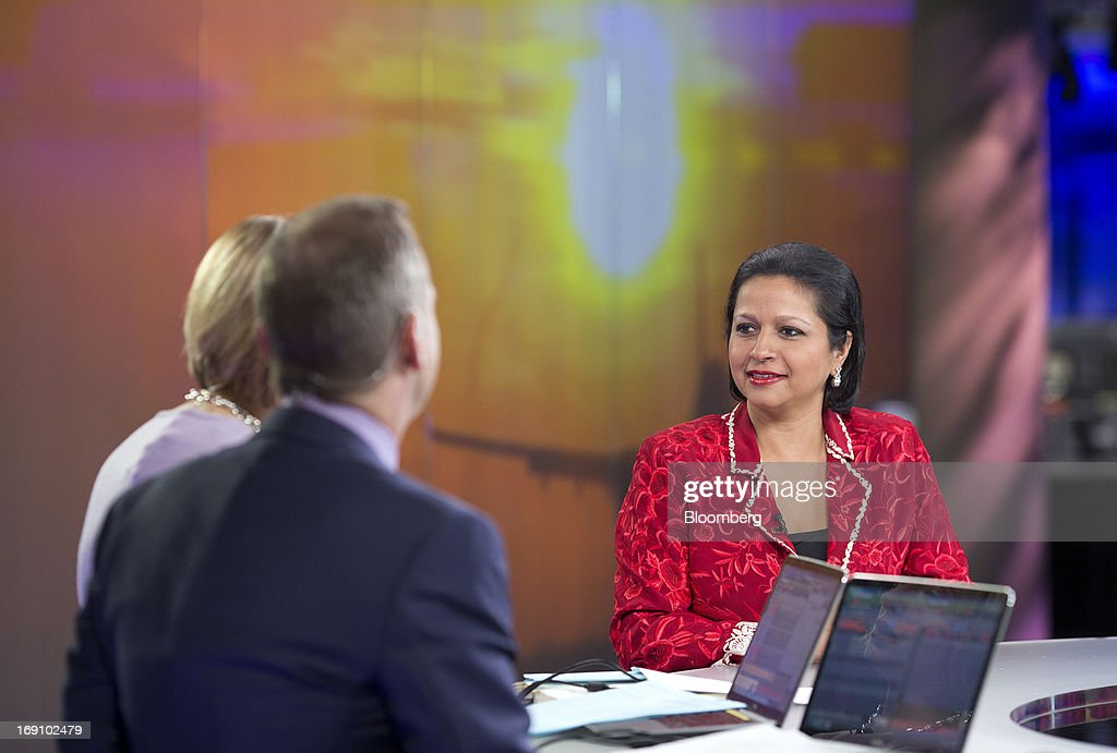 Priya Paul, chief executive officer of Apeejay Surrendra Park Hotels Ltd., right, speaks during a Bloomberg Television interview in London, U.K. on Monday, May 20, 2013. India's tourism ministry is seeking to increase tourist arrivals by 12 percent a year up to 2016 to double foreign exchange earnings. Photographer: Simon Dawson/Bloomberg via Getty Images
