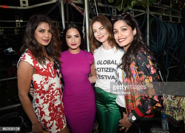 Priyanka Chopra Demi Lovato Michelle Monaghan and and Freida Pinto pose backstage during the 2017 Global Citizen Festival in Central Park on...