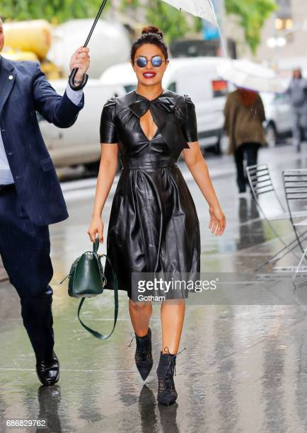 Priyanka Chopra is all smiles walking under the umbrella when out and about in the rain promoting 'Baywatch' in New York