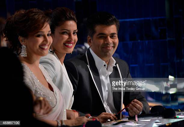Priyanka Chopra Madhuri Dixit and Karan Johar on the sets of reality dance show Jhalak Dikhla Ja in Mumbai