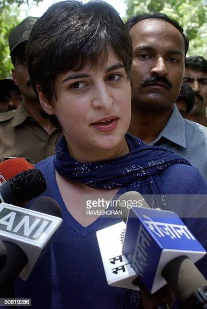 Priyanka Gandhi daughter of India's opposition leader Sonia Gandhiis accompanied by security personnel as she addresses a media gathering after...