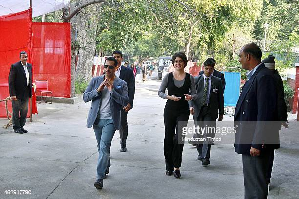 Priyanka Gandhi Vadra and Robert Vadra arrives to cast their vote at a polling station during the Delhi Assembly Elections 2015 at Aurangjeb Lane on...