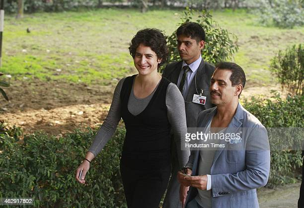 Priyanka Gandhi Vadra and Robert Vadra coming out after casting their vote at a polling station during the Delhi Assembly Elections 2015 at Aurangjeb...