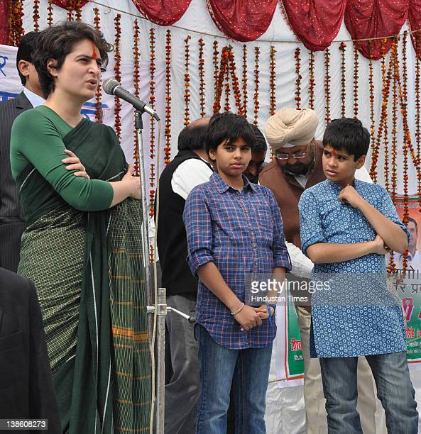 Priyanka Gandhi Vadra her son Raihan and daughter Miraya attend an election rally on February 9 2012 in Rae Barelly India For the older generations...